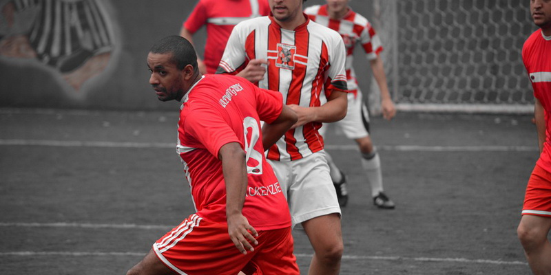 Players of two teams with red and white clothes
